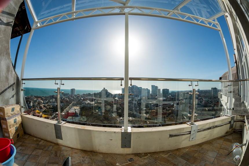 стеклянное ограждение козырька и балкона